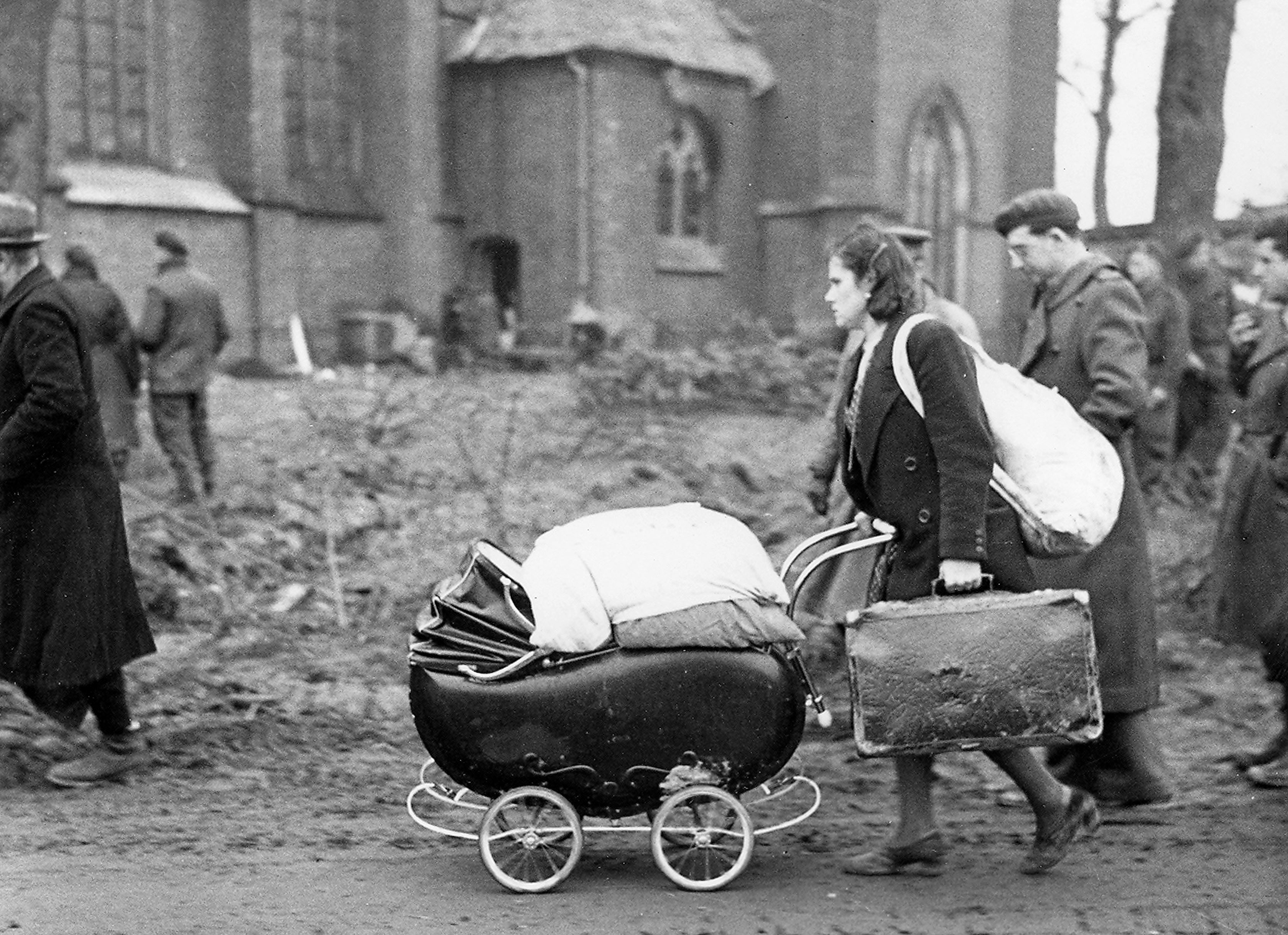 Evacuees woman with stroller